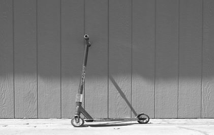 links to an image of a scooter by a wall